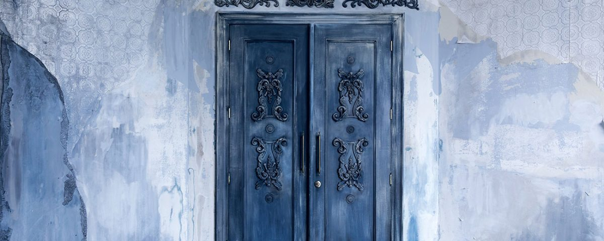 antique-doors-in-aging-mansion